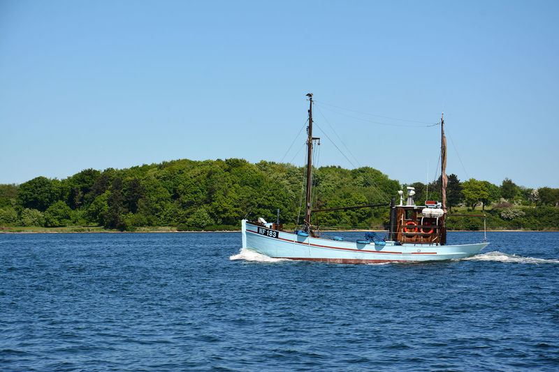 Old danish fishing boat Blue Boat Clear Sky Day Denmark Fishing Boat Nature No People Old Boat Outdoors Passing By Sailing Sea Summer Tree Water Waterfront