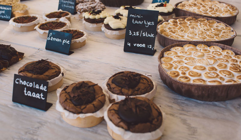 Chocolate Lemon Pie Market Taart Arrangement Choice Close-up Communication Day Food Food And Drink For Sale Freshness High Angle View Indoors  Large Group Of Objects No People Pie Price Tag Ready-to-eat Retail  Sweet Food Sweets Text Variation Western Script