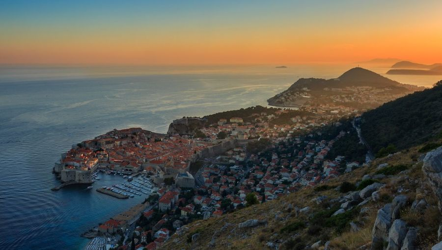 Sunset of old town Dubrovnik Dubrovnik, Croatia Sunset Sea High Angle View Scenics Nature Built Structure Beauty In Nature House Mountain Building Exterior Architecture Outdoors Water Horizon Over Water No People Sky Landscape Day