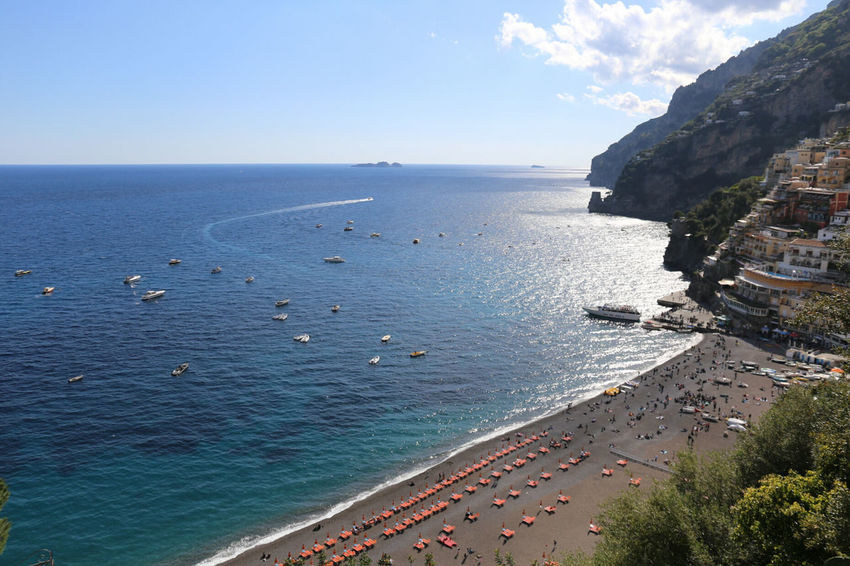Sea Beach Horizon Over Water Water Outdoors Sand Scenics Travel Destinations Vacations High Angle View Nature Building Exterior Architecture Sky No People Cliff Blue Beauty In Nature Day Tranquility Positano, Italy Travel