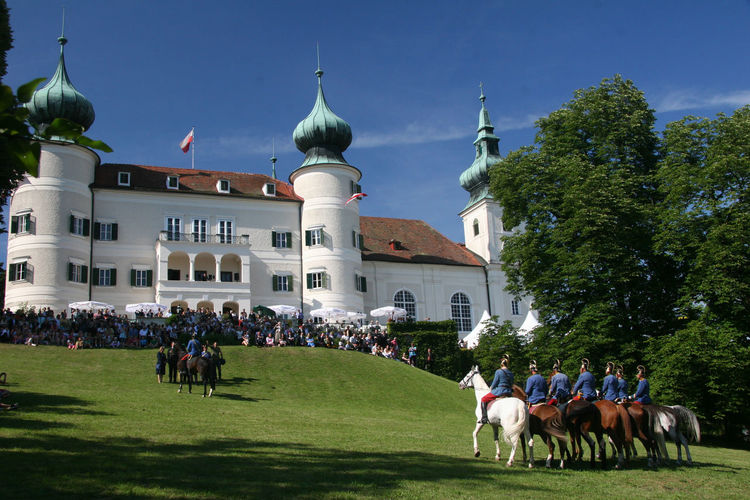 Artstetten Castle In June. The Archduke Franz Ferdinand and Sophie, Duchess of Hohenberg were interred at Artstetten Castle because his wife could not be buried at the Imperial Crypt in Vienna. The assassination of Archduke Franz Ferdinand and his wife Sophie in Sarajevo on 28th June, 1914, is widely seen as the spark that ignited the flames of a First World War. Once a summer residence of the imperial family, Artstetten Castle (open April to November) is the final resting place of Archduke Franz Ferdinand and his wife Sophie Duchess of Hohenberg. On this sunny day in June, Austrian men on horseback paraded around in Austro-Hungarian military uniforms of the period. The museum inside the castle, shows memorabilia from around the time of the assassination; a living war memorial like no other. http://pics.travelnotes.org/ Artstetten Artstetten Castle Austria Castle European  Habsburg Michel Guntern Schloss Schloss Artstetten Tourist Attraction  Travel Photography Austrian Blue Sky Blue Sky Background Building Exterior Europe Grass Historical Horse Large Group Of People Military Uniform Real People Sky Travelpics World War One