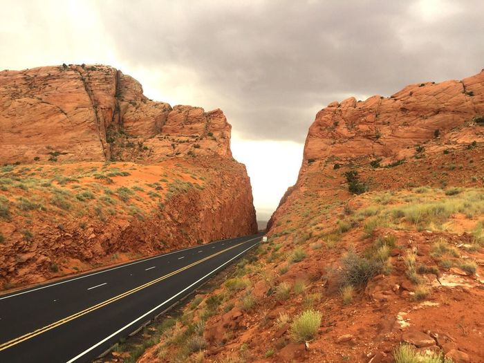 Transportation Road Mountain Tranquil Scene Rock - Object Scenics Landscape Cloud - Sky Non-urban Scene Mountain Road Travel Destinations Tunnel Sky Rock Formation Curve Nature Tranquility Cliff Physical Geography