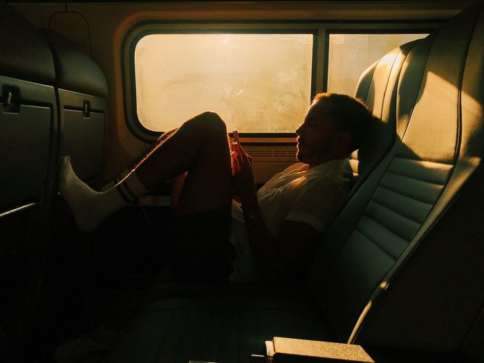 Traveling from BOS to NYC the sun was seeping beautifully through the window. NYC Natural Light Sunlight The Street Photographer - 2018 EyeEm Awards Rays Shadow Sitting Soft Ligjt Transportation Travel Warm Window