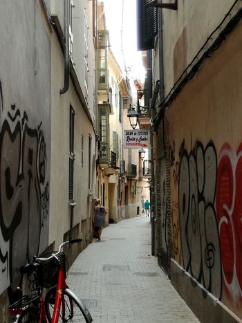 Palma De Mallorca Streetphotography Streets Of Palma City Bicycle Alley Residential Building Street Graffiti Architecture Building Exterior Built Structure Lane Narrow Passage Street Art vanishing point Diminishing Perspective City Street