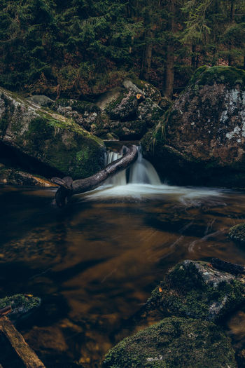 Waterfall on the river jedlova in the middle of the czech wilderness in the jizera mountains