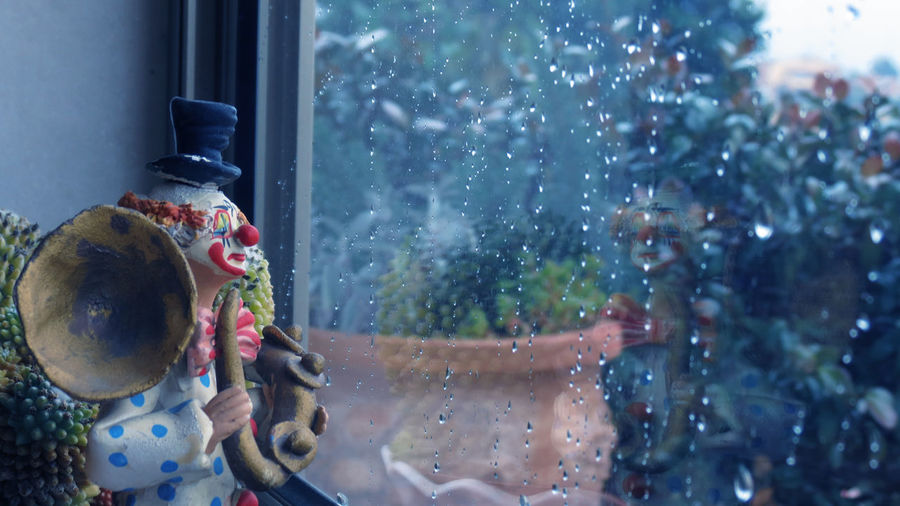Clown Day Indoors  Moment Outdoors Rain Rainy Days Sad Sadness Sadness Smi Statue Window Window Washer