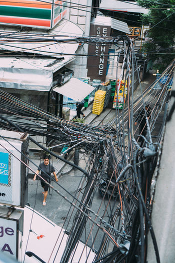 High angle view of telephone pole amidst buildings in city