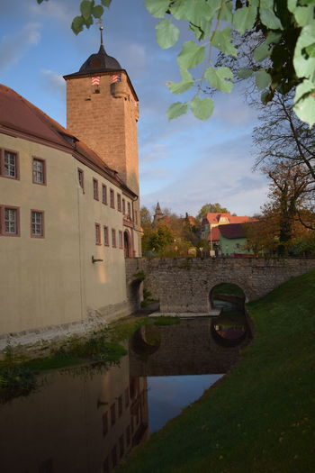 Die Wasserburg in Kapelendorf Castle Architecture Bell Tower Building Exterior Built Structure Castle Tower Castle View  Day History Moat Nature No People Outdoors Sky Tree Water