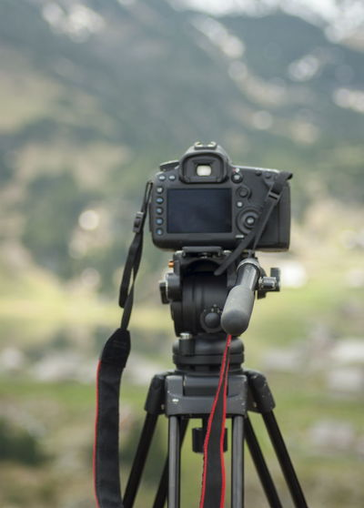 Camera ready to nature waterfall landscape Beauty In Nature Black Color Camera Camera - Photographic Equipment Close-up Day Digital Camera Environment Equipment Field Focus On Foreground Land Nature No People Outdoors Photographic Equipment Photography Themes Technology Tree Tripod