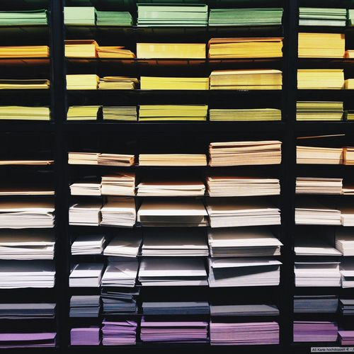 Multi colored documents in a rack