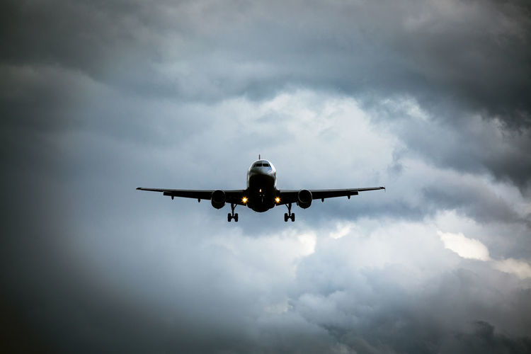 Low angle view of airplane flying in sky