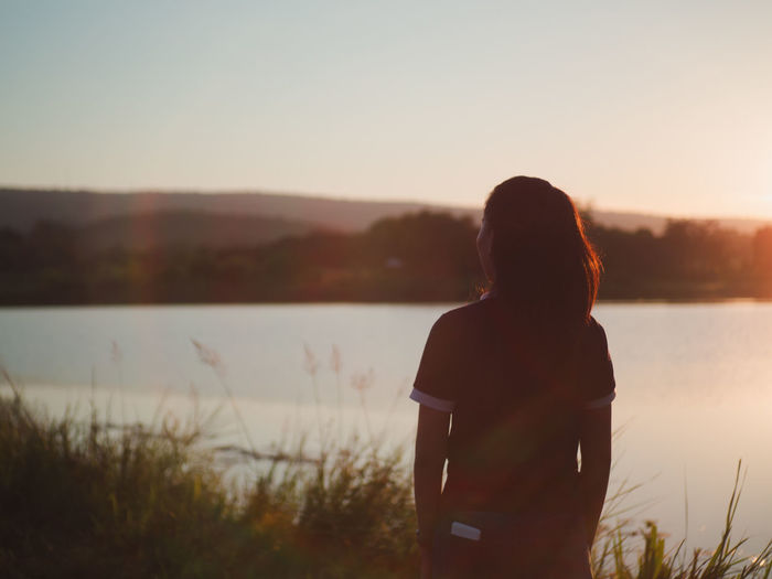 Silhouette Travel Photography Beauty In Nature Casual Clothing Hairstyle Lake Leisure Activity Lifestyles Looking At View Nature One Person Outdoors Real People Rear View Scenics - Nature Sky Standing Sunset Three Quarter Length Tranquil Scene Tranquility Water Women EyeEmNewHere