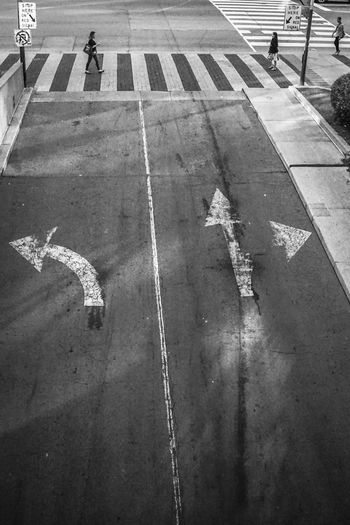 life is full of arrows Blackandwhite Monochrome Pedestrian Traffic Road High Angle View Asphalt White Line Pedestrian Crossing Sign Pedestrian Sign Information Symbol Road Marking Arrow Sign Crosswalk Double Yellow Line