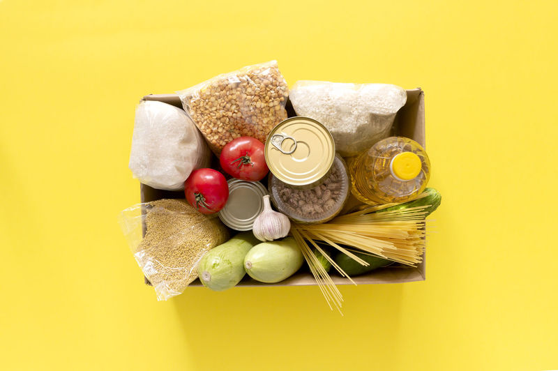 High angle view of candies against yellow background