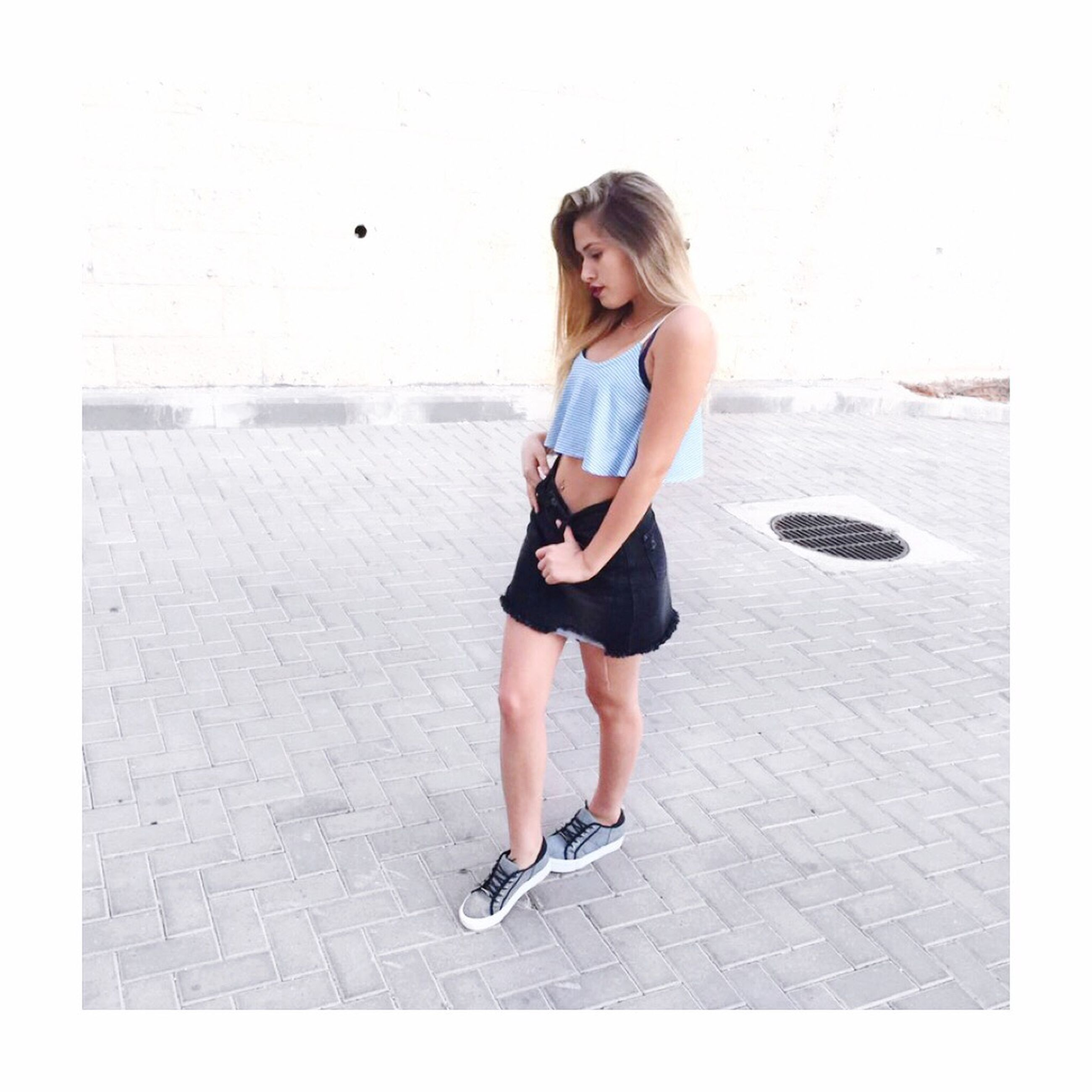 full length, casual clothing, person, young adult, lifestyles, leisure activity, young women, fashionable, shoe, long hair, day, outdoors