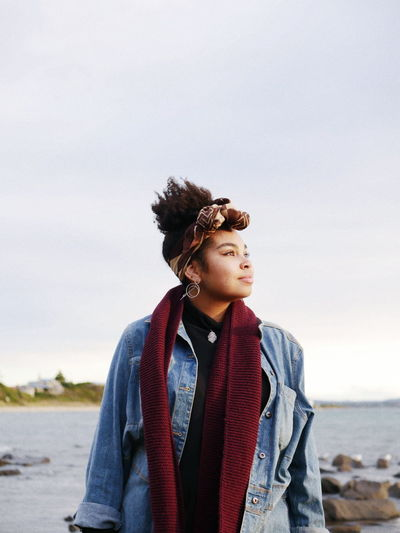 Nigerian Australian Tasmania Windy Moody Friends VSCO Vscocam Beach Water Photography Portrait Looking Away From Camera Golden Hour Light Cold Tones Woman Female Powerful Beautiful Natural Beauty Nature Water Warm Clothing Beach Sea Sky Scarf