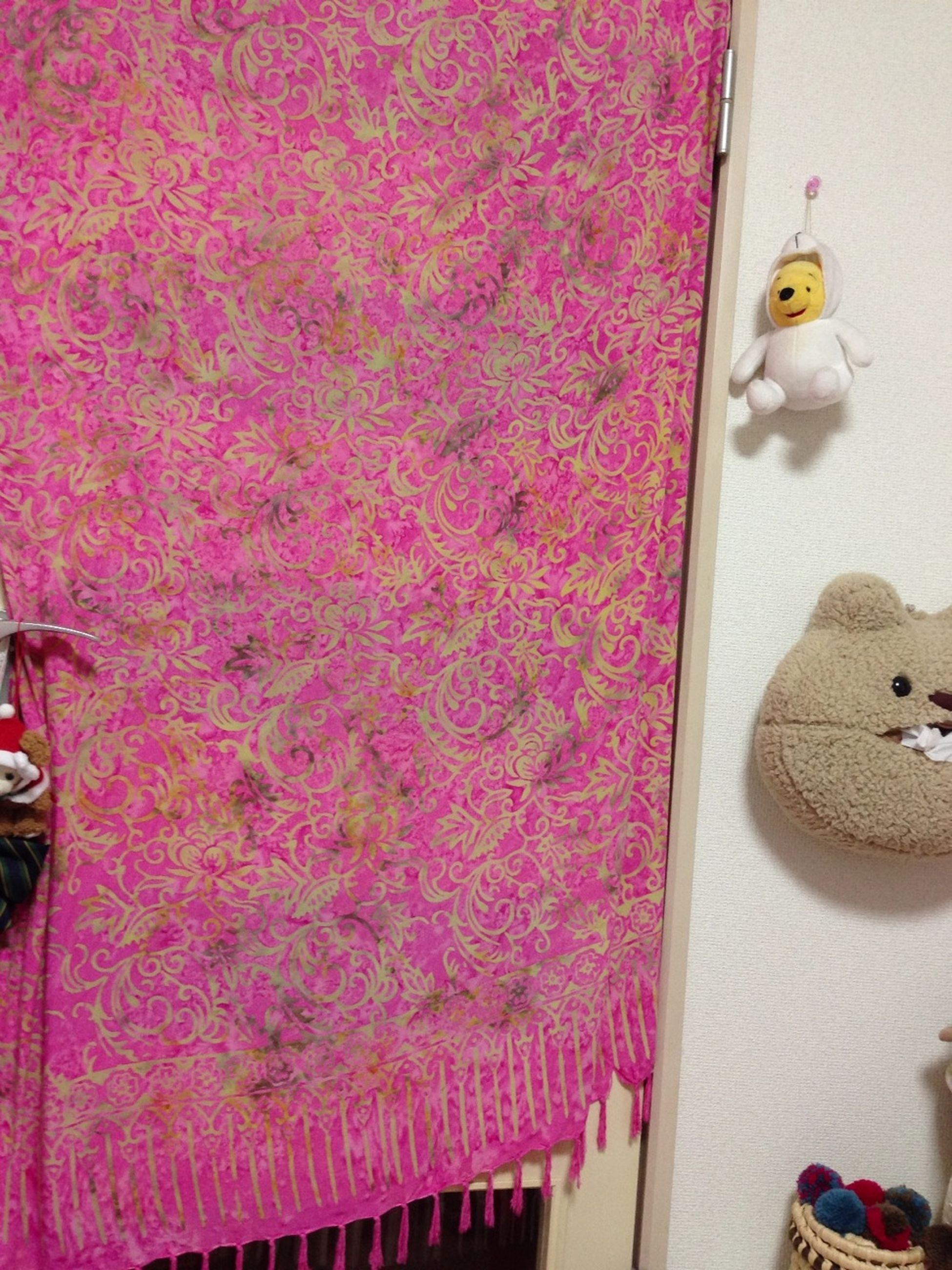 indoors, wall - building feature, multi colored, variation, toy, still life, home interior, no people, high angle view, animal representation, table, textile, pink color, red, hanging, close-up, art and craft, metal, fabric, decoration