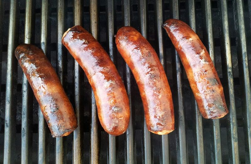High angle view of sausages on barbecue