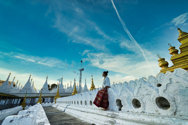 Panoramic view of statues on building against sky