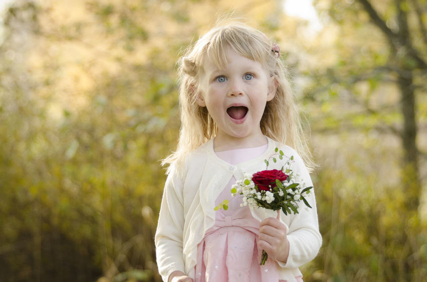 Girl Child Flower Face Dressed Up Wedding Day Little Girl Flowers Boquet Of Flowers Outdoors