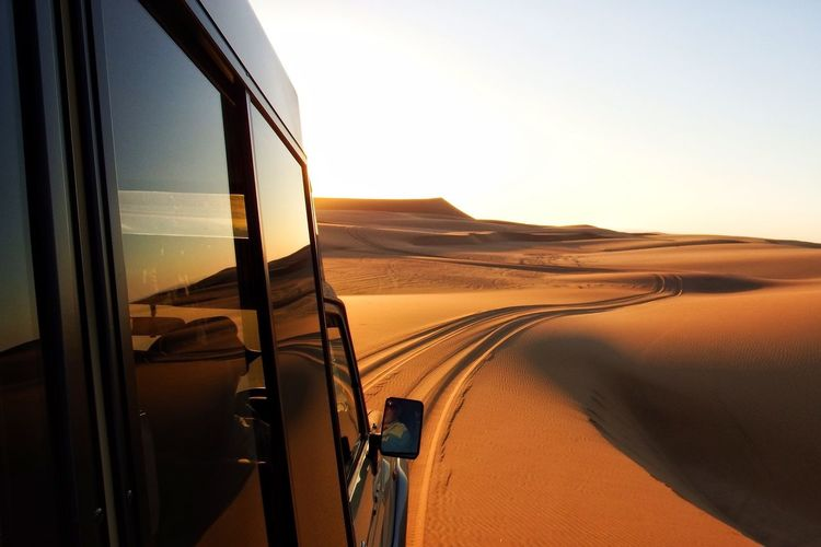 An Eye For Travel Arid Climate Beauty In Nature Car Day Desert Finding New Frontiers Landscape Nature No People Off-road Vehicle Outdoors Sand Sand Dune Scenics Sky Sunset Travel Transportation