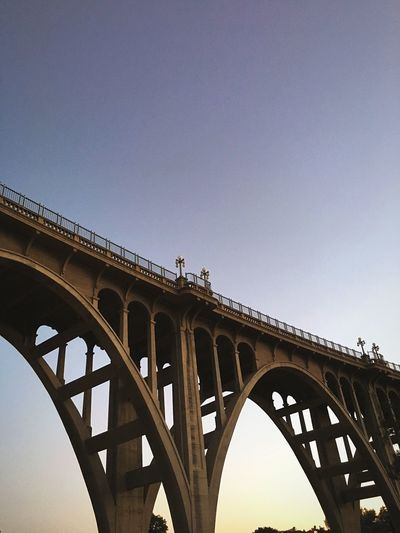 Low angle view of arch bridge against clear sky