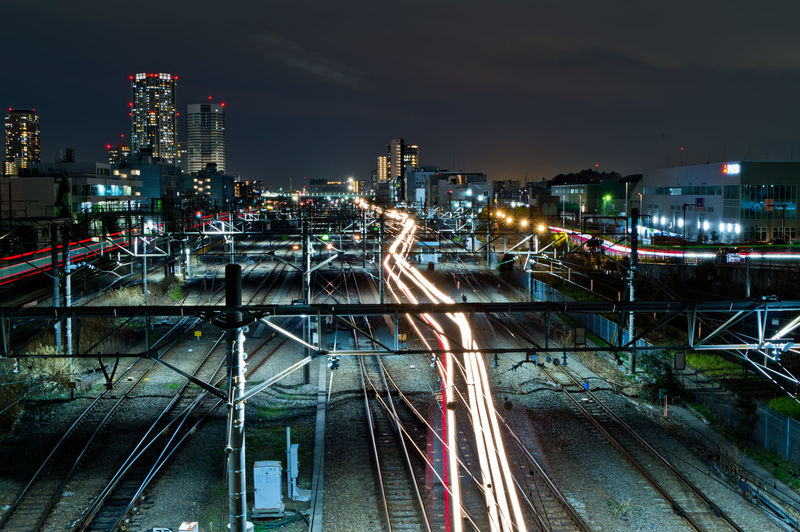 High angle view of light trails on railways in city