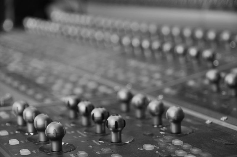 Mixing Desk in a Recording Studio Audio Engineering Audio Equipment Desk Knobs And Dials Music Recording Session Sound Desk Angled Arts Culture And Entertainment Audio Electronics Black And White Blackandwhite Console Focus On Foreground Knobs Mixer Mixing Musical Instrument Recording Recording Desk Recording Studio Sound Design Sound Engineer Sound Recording Equipment Studio Equipment