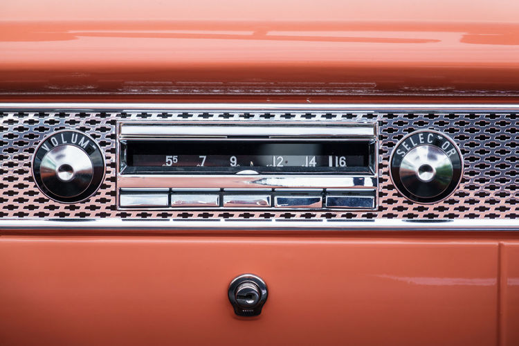 Old classic car radio in the dashboard Car Radio Car Interior Radio Retro Styled No People Control Panel Car Music Close-up Motor Vehicle Chrome Radio Old Retro Retro Car Nostalgia Glove Compartment Classic Car Fifties American Vintage Car Collectors Car Oldtimer Nostalgic  Pink Color Audio Equipment Audio Stereo