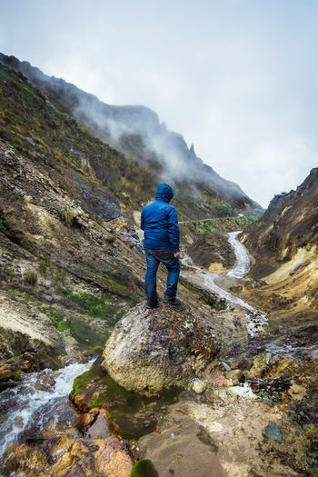 Lost In The Landscape Adult Adventure Backpack Beauty In Nature Casual Clothing Climbing Day Full Length Hiking Leisure Activity Lifestyles Men Mountain Mountain Range Nature One Man Only One Person Outdoors People Real People Rear View Rock - Object Scenics Sky Standing