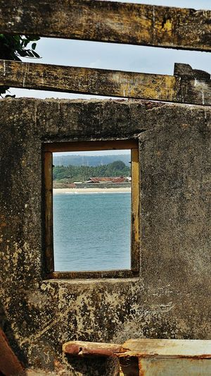 Window of opportunities in Goa Vengurlabeach Vengurla Port Window Sand Sea Sky Tranquility Tranquil Scene No People Ruins Still Beautiful Blue Water Blue Sky And Sea Opportunities Waterfront Beauty In Nature Konkandiaries Scenic View Perspective