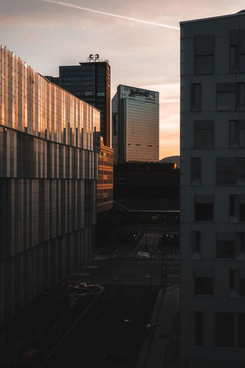 Modern buildings in city during sunset