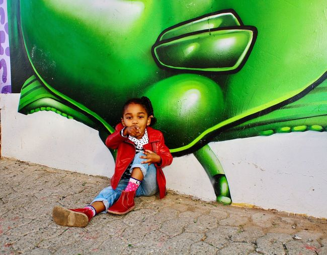 Graffiti Full Length Childhood Portrait Green Color Casual Clothing Looking At Camera Smiling Favorite Beautiful Sitting Pointing Maboneng Precinct