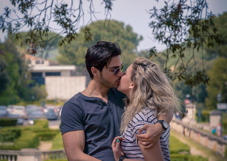 Blonde Blonde Hair Bokeh Bokeh Photography Capture The Moment Couple Couples Feel The Journey Focus On Foreground Holiday Hugs Kiss Kisses Kissing Lifestyles Long Hair Love Man Me Moments Portrait Sunglasses That's Me People And PlacesYoung Couple The Portraitist - 2017 EyeEm Awards