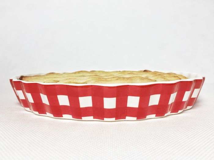 Close-Up Of Tart Against White Background