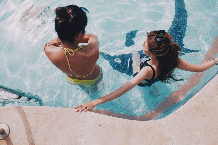 Last days of summer Summertime Summer Swimming Pool Pool Leisure Activity Lifestyles Water Real People Women Sunglasses Emotion Togetherness Girls High Angle View