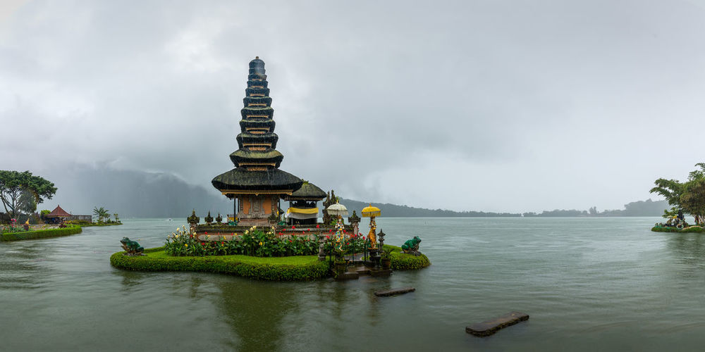 Statue of temple against cloudy sky