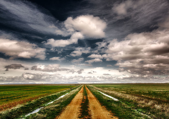 A road somewhere in Spain Background Blue Cloud Countryside Daylight Forward Graphic Green Ground Harsh Infinity Landmark Landscape Nature Nobody Non-urban Outdoor Rural Vivid Rut Road Scenic Vanishing Point Wallpaper Sky