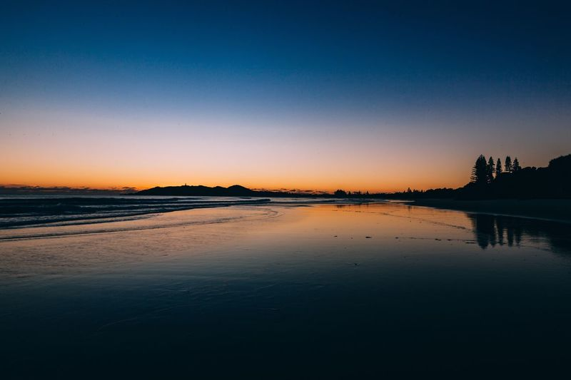 Sunset Water Tranquil Scene Clear Sky Scenics Tranquility Copy Space Dusk Beauty In Nature Sea Idyllic Waterfront Calm Reflection Nature Orange Color Blue Shore Outdoors Majestic Sunrise Byronbay The Traveler - 2018 EyeEm Awards