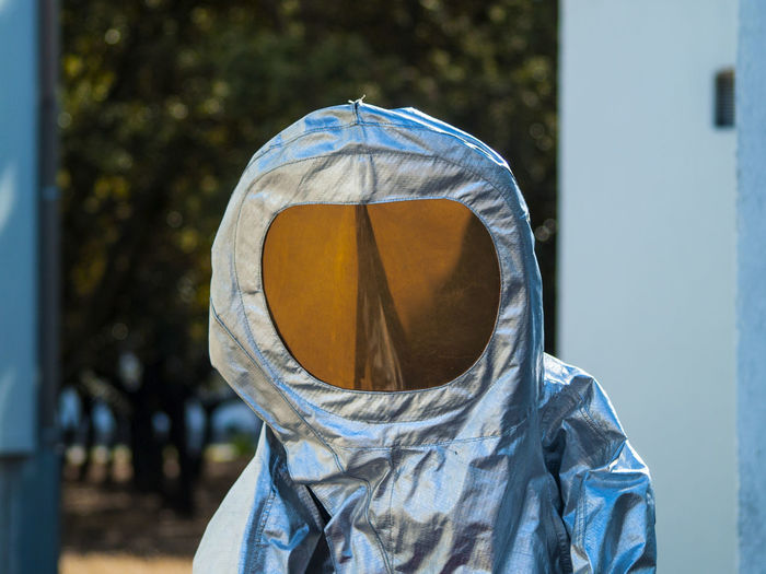 Person in protective workwear standing outdoors
