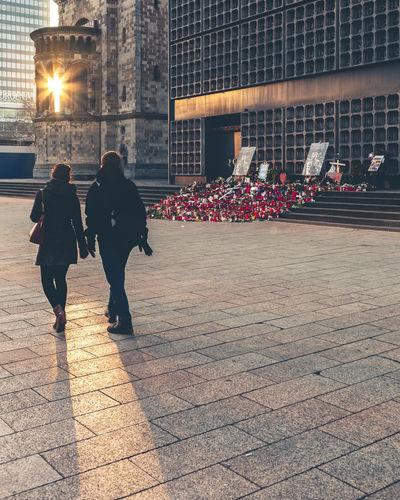 Don't forget Street The City Light City Outdoors Lifestyles Women Winter Men People Togetherness Adult Couple Unrecognizable Person Breitscheidplatz Berlin Deutschland Tourism Gedächtniskirche Kurfürstendamm Charlottenburg  City West Love No Hate Misery