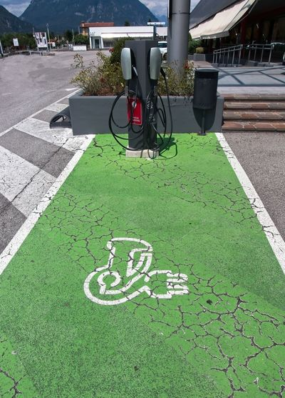 Bicycle sign on footpath in city