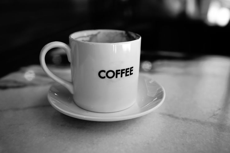 Mug Cup Food And Drink Coffee Cup Drink Coffee Text Coffee - Drink Refreshment Still Life Table Western Script Indoors  Communication Close-up No People Crockery Saucer Focus On Foreground Freshness Non-alcoholic Beverage