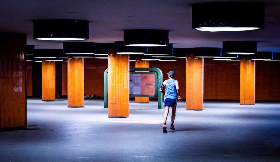 Man Running In Illuminated Basement
