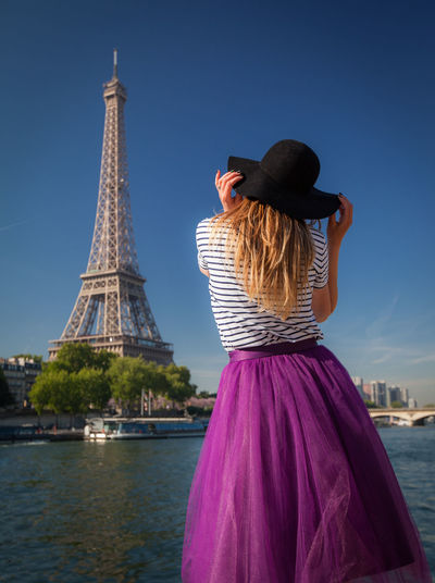 Artistic and natural portrait of beautiful woman in the nature. Woman Face Portrait Beautiful Beauty Smile Female Girl Young Hair Natural Nature Outdoors Skin White Happy Attractive Background Lifestyle Fashion Cute Hat Eiffel Tower Paris Summer Architecture Real People Built Structure Rear View Travel Destinations One Person Lifestyles Water Tower Sky Travel Women Tourism Building Exterior Leisure Activity Adult City Tall - High Hairstyle