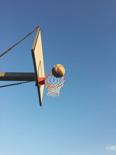 Playing basketball against sky Basketball Hoop Low Angle View Basketball - Sport Sport Copy Space Blue Day Clear Sky Making A Basket No People Outdoors EyeEm Selects Play Basketball Game Win Playing Healthy Lifestyle Basket Basketball Net - Sports Equipment Outside Energy Summer Sky