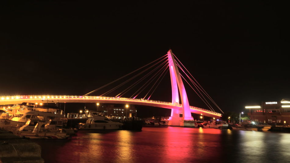 Tamshui Fisherman Wharf in Taiwan Taiwan EyeEmNewHere Taipei Tamshui Danshui Tamsui Dansui Taiwan New Taipei City Tamshui River Night Bridge - Man Made Structure Illuminated Built Structure Connection Architecture City Travel Destinations River Transportation Long Exposure Outdoors Suspension Bridge Multi Colored Building Exterior Reflection Cityscape Light Trail Water Sky
