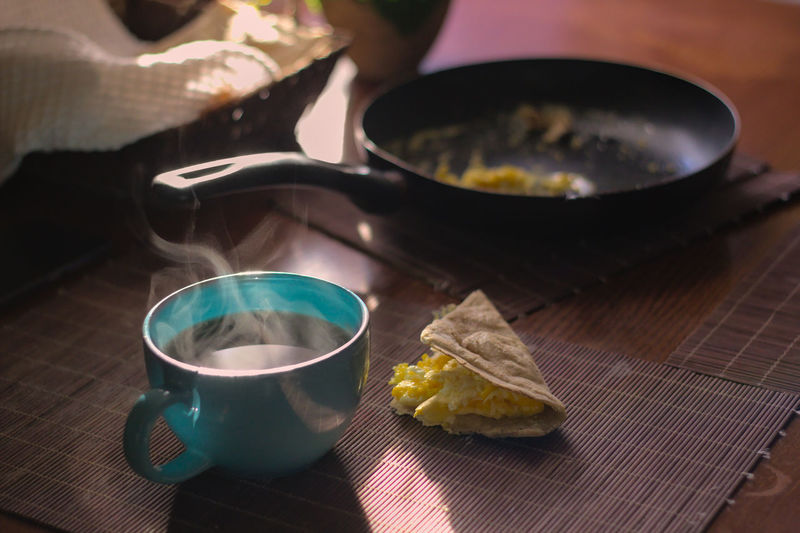 Breakfast in the morning, cold, hot tea, steam, scrambled eggs, dark photography food