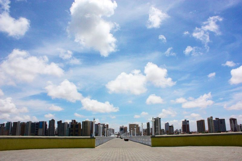 Pathway Amidst Buildings Against Sky