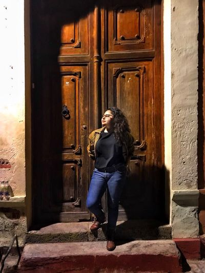 Door Full Length Front View Young Adult One Person Young Women Entrance Real People Doorway Built Structure Casual Clothing Architecture Day Beautiful Woman Building Exterior Standing Posing Leisure Activity Outdoors Lifestyles